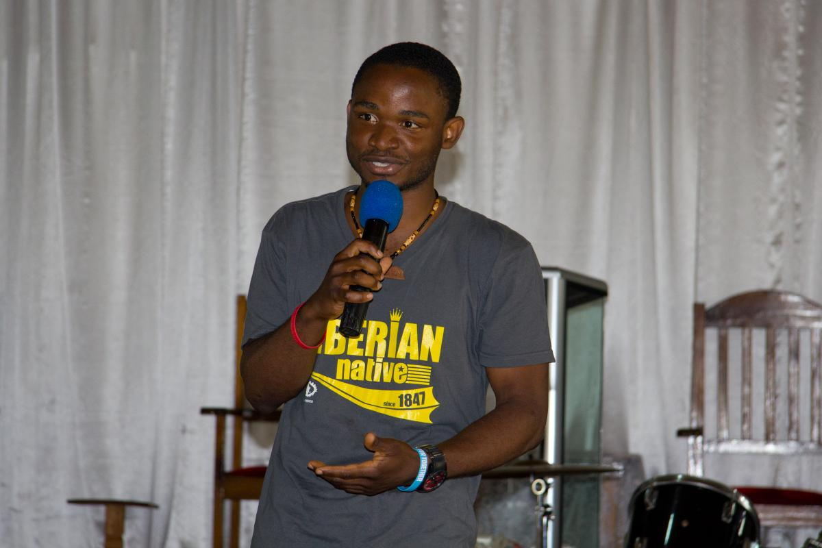 Jong Massaquoi speaking at a conference in 2013.